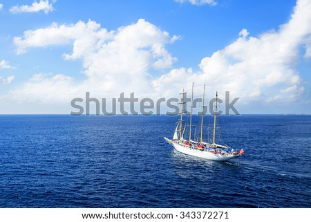 Yacht is sailing on the Caribbean sea on a sunny day. - stock photo