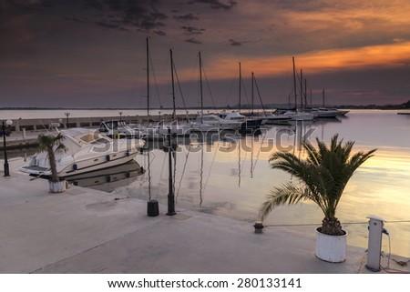 Yacht marina at sunset - stock photo
