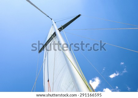Yacht Mast Against Blue Skies. Horizontal Image Orientation - stock photo