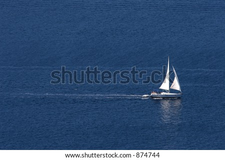 Yacht moving across a blue sea - stock photo