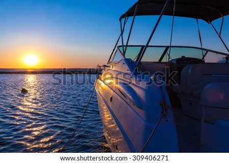 Yacht near the pier against sunset, summer vacation concept