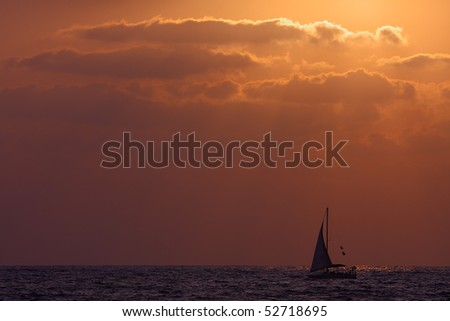 Yacht on Mediterranean Sea at sunset.