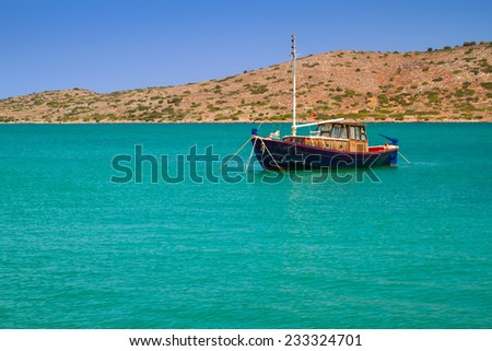 Yacht on the blue lagoon of Crete, Greece - stock photo