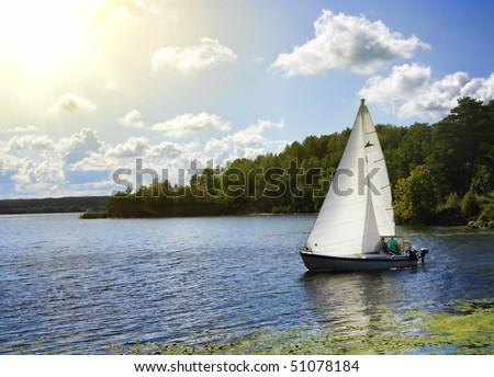 yacht on the lake - stock photo