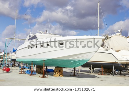 yacht repairs, summer cloudy sky