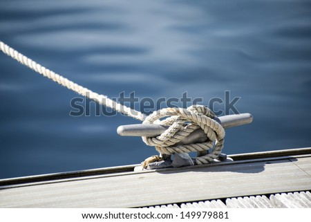 Yacht rope cleat detail image - stock photo