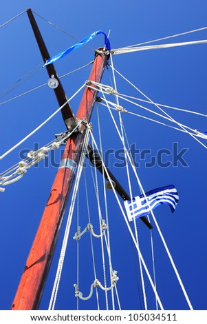 yacht's hinge with sail rolled-up - stock photo