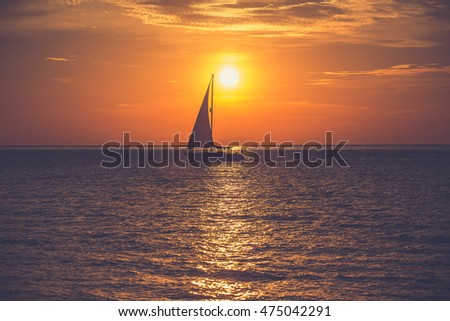 Yacht sailing against sunrise. Holiday lifestyle landscape with skyline. Gdynia Orlowo