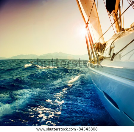 Yacht Sailing against sunset.Sailboat.Sepia toned - stock photo