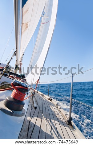 Yacht sailing in the sea in sunny day - stock photo