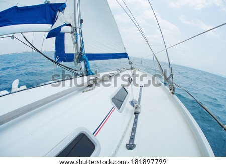 Yacht sailing in the tropical sea - stock photo
