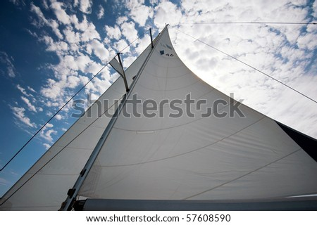 yacht sails against sun - stock photo