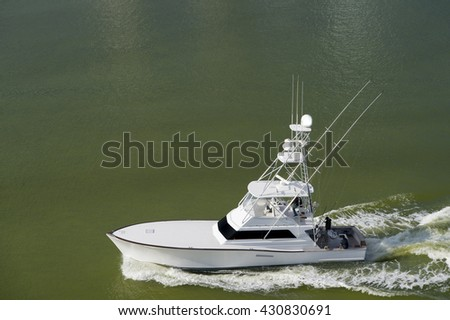 Yacht white color floating in green water sunny day, copy space - stock photo