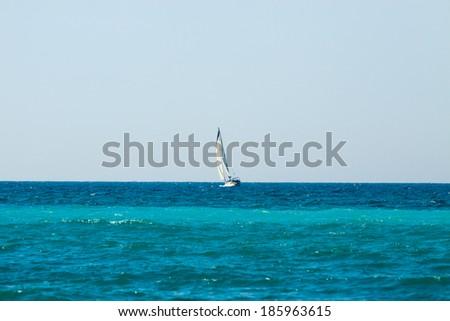 Yacht with sail on Mediterranean Sea - stock photo