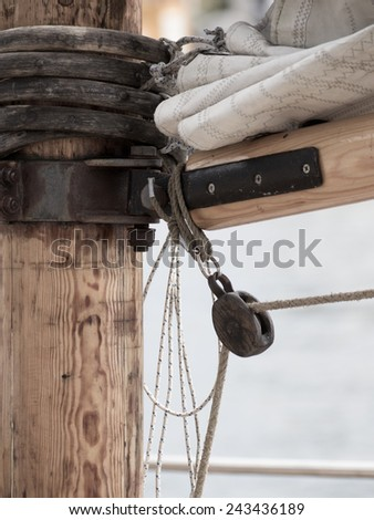 Yachting. Detail image of mast and sail system on yacht sailboat - stock photo