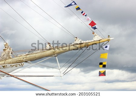 Yachting. Part of sail yacht and nautical thick cord on sky background - stock photo