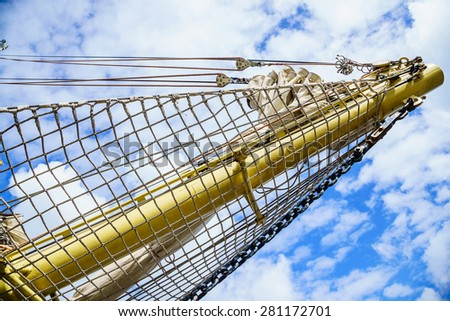 Yachting. Sailboat view of different parts of yacht. Mast against blue sky. - stock photo