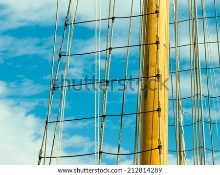 Yachting. Sailboat view of different parts of yacht. Mast against blue summer sky - stock photo