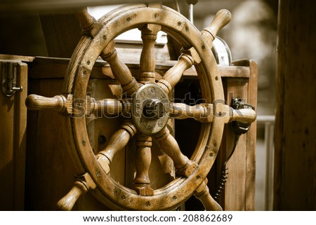 Yachting. Sailboat view of different parts of yacht. Ship wooden old steering wheel. - stock photo
