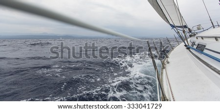 Yachting sport. Sailing in the wind through the waves. Sailing regatta.
