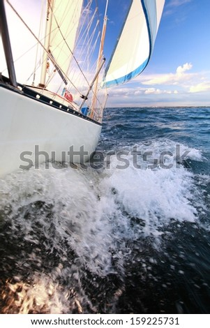 Yachting yacht sailboat sailing in baltic sea blue sky sunny day summer vacation. Tourism luxury lifestyle. - stock photo