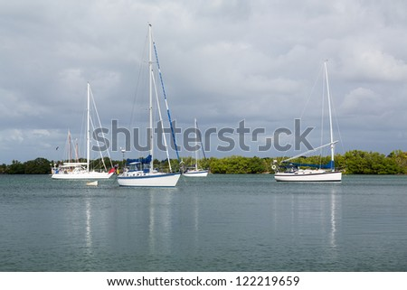 Yachts and boats moored in No Name Harbor in Bill Baggs Cape Florida State park Key Biscayne Miami - stock photo