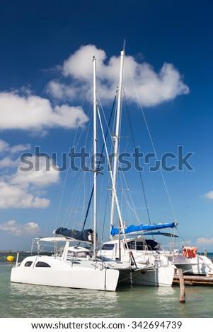 Yachts and sailboats moored in marina. Summertime vacation - stock photo