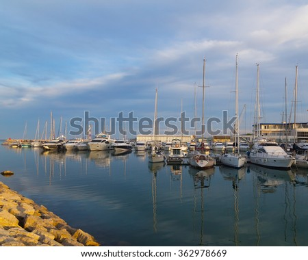 Yachts and sailboats moored in the marina near Valencia, Spain. Sailing is one of the most favorite recreational activities in Spain where almost every coastal town has a picturesque marina.  - stock photo