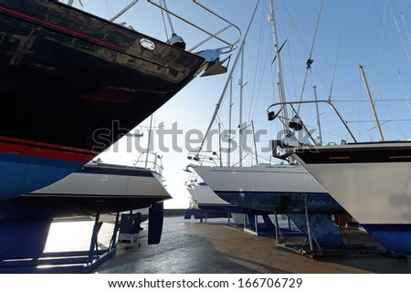 Yachts ashore in a boatyard for the winter in the UK - stock photo