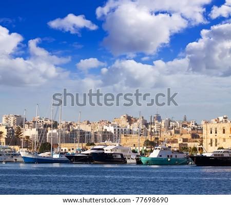 Yachts at Marsamxett harbour  against Manoel island. Malta - stock photo