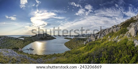 Yachts in a bay during sunset - National Park Kornati - Croatia - stock photo