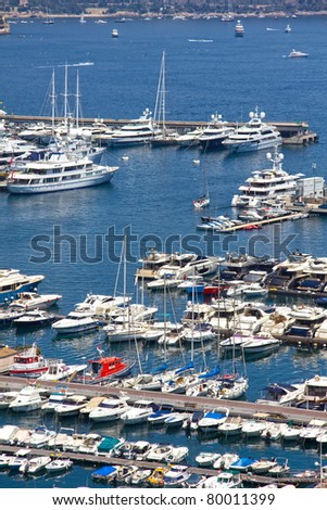 Yachts in Monaco harbor - stock photo