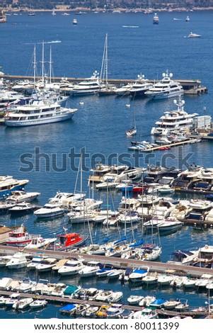 Yachts in Monaco harbor - stock photo