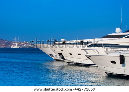 Yachts in  sea near  the island on background of the sky - stock photo