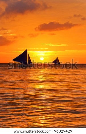 yachts in sunset - stock photo