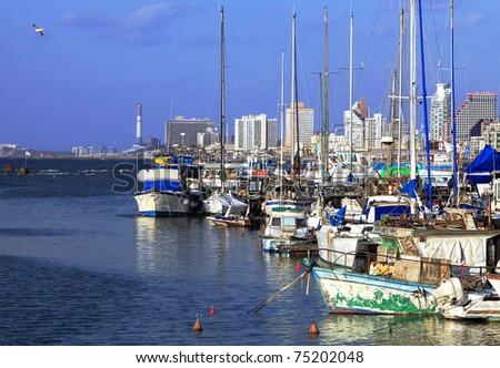 Yachts in Yaffo port (Israel) on Tel-Aviv background - stock photo