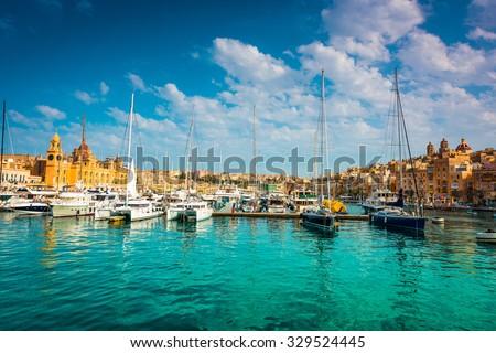 yachts near pier in Birgu near Cospicua in Malta - stock photo