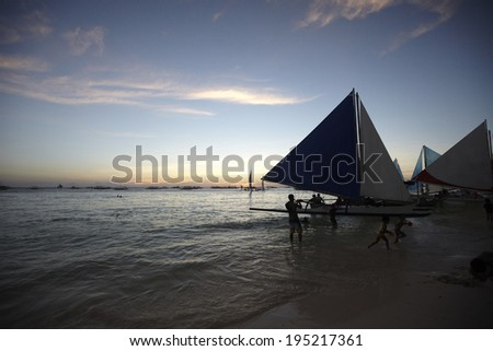 Yachts on the beach at sunset in the Philippines