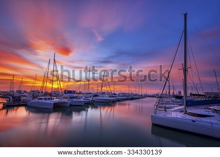 Yachts parking in the Adriatic harbour in croatia in sunset  - stock photo