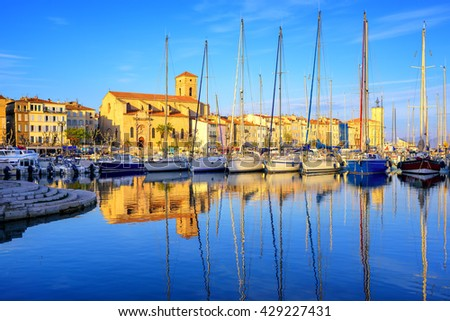 Yachts reflecting in blue water in the old town port of La Ciotat, Marseilles district, France, in the evening light