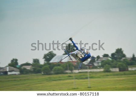 "YAKHROMA, RUSSIA - JUNE 25: A Robinson R44 from the First Helicopter Club ""Aerosoyuz"" performs at the Carlson Cup-2011 Competitions for helicopters sports on June 25, 2011 in Yakhroma, Russia."