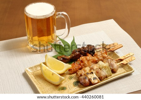 yakitori japanese grilled chiken  with beer - stock photo