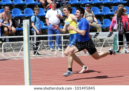 YALTA, UKRAINE - APRIL 25: Unidentified boys age 16-17 on the 100 meters race on Ukrainian Junior Track and Field Championships on April 25, 2012 in Yalta, Ukraine.