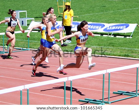 YALTA, UKRAINE - APRIL 25:  Unidentified girls age 16-17 on the 100 meters hurdles race on Ukrainian Junior Track and Field Championships on April 25, 2012 in Yalta, Ukraine - stock photo