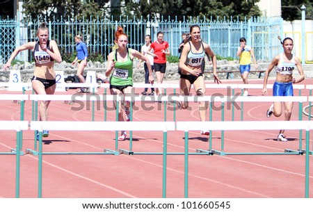 YALTA, UKRAINE - APRIL 25: Unidentified girls age 16-17 on the 100 meters hurdles race on Ukrainian Junior Track and Field Championships on April 25, 2012 in Yalta, Ukraine.