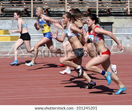 YALTA, UKRAINE - APRIL 25: Unidentified girls age 16-17 on the 100 meters race on Ukrainian Junior Track and Field Championships on April 25, 2012 in Yalta, Ukraine. - stock photo
