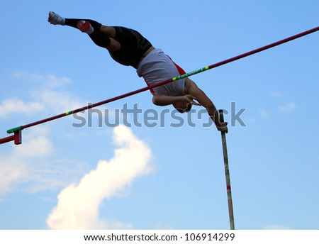 YALTA, UKRAINE - JUNE 01: Haletski Rostislav compete in the pole vault competition on Ukrainian Junior Track and Field Championships on June 01, 2012 in Yalta, Ukraine - stock photo
