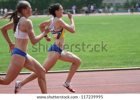 YALTA, UKRAINE - JUNE 02: (L-R) Tkachuk Viktoria and Ralko Oksana compete in the 200 meters race on Ukrainian Track & Field Championships on June 02, 2012 in Yalta, Ukraine - stock photo
