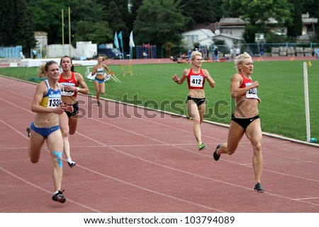 YALTA, UKRAINE, MAY 28: (L-R) Piatochenko Viktoria, Bryzgina Elyzaveta, Mariya Ryemyen and Pogrebniak Natalia on finish 200 meters dash on Ukrainian Cup in Athletics, on May 28, 2012 in Yalta, Ukraine - stock photo