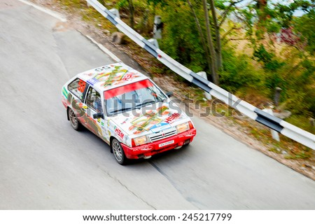 YALTA, UKRAINE - SEPTEMBER 14. Vladimir Apostolyuk drives his VAZ 2108 during the WOG Yalta Rally Fest 2013. 2 day. on September 14, 2013 in Yalta, Ukraine. - stock photo